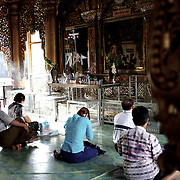 May 09, 2013 - Yangon, Myanmar: Buddhist devotees pray at Sule Pagoda in central Yangon. (Paulo Nunes dos Santos/Polaris)