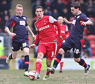 Picture by David Horn/Focus Images Ltd +44 7545 970036.23/02/2013.Mathieu Baudry of Leyton Orient and Nicky Adams and Matt Sparrow of Crawley Town during the npower League 1 match at the Matchroom Stadium, London.