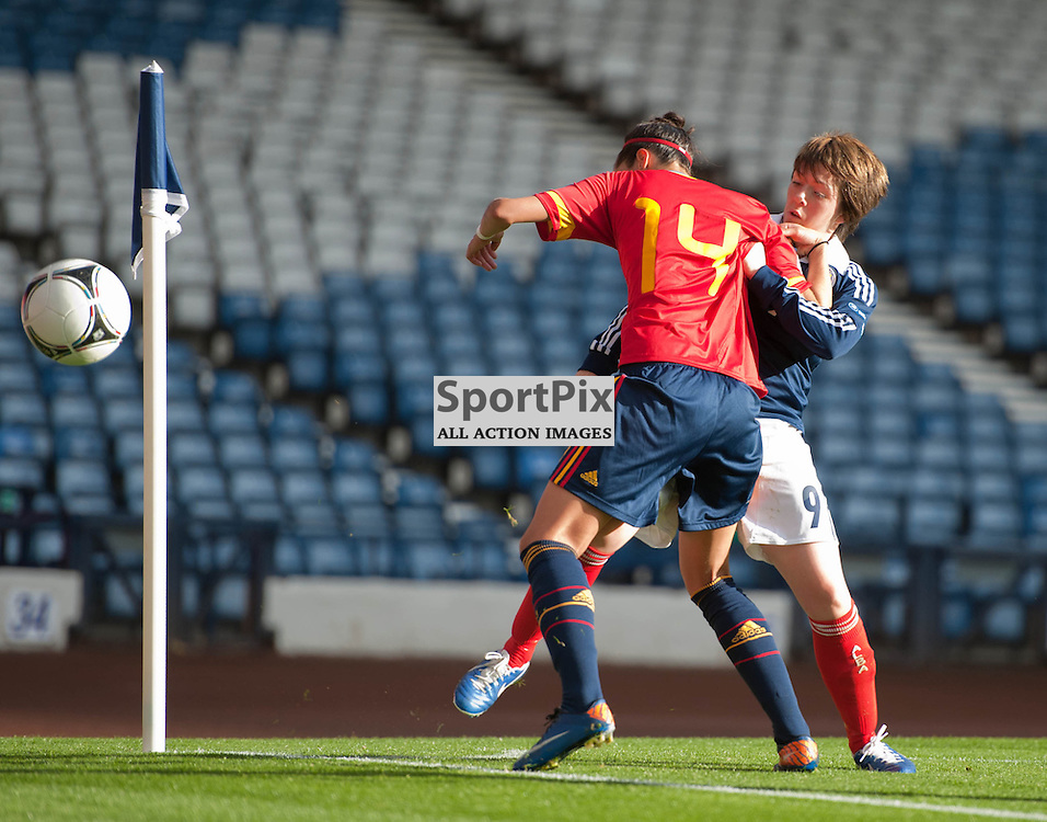 Spain's Jennifer Hermoso and Scotland's Megan Sneddon in action.UEFA Women's Euro 2013 Play-offs, Scotland v Spain, Hampden Park, Glasgow, 20 October 2012 Angela Isac | StockPix.eu