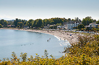 Willows Beach, in Oak Bay Victoria, BC, is a wide sandy stretch of beach that attracts people to walk and relax.