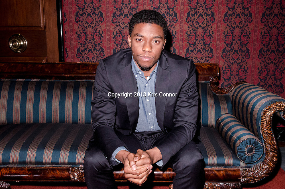 "WASHINGTON, DC - APRIL 15:  Actor Chadwick Boseman, poses for a photo during the Washington DC screening of Warner Bro's film ""42"" at Smithsonian Museum of American History on April 15th, 2013. Guests included star of the film Chadwick Boseman, John Gray, Carol Melton, and Lonnie Bunch. Photo by Kris Connor/Warner Bros"