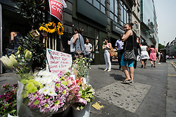 © Licensed to London News Pictures. 16/07/2013. London, UK.  Passers by view a memorial to the cyclist killed yesterday by a tipper truck at the scene of the incident in central London Photo credit : Richard Isaac/LNP