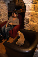 Paris, France - Oct 2013: Inspired by neko cafes in Japan, Margaux Gandelon has opened a cafe where the lovers of cats can have a drink in company of many cats. (photo Bruno Vigneron/Getty Images)<br />