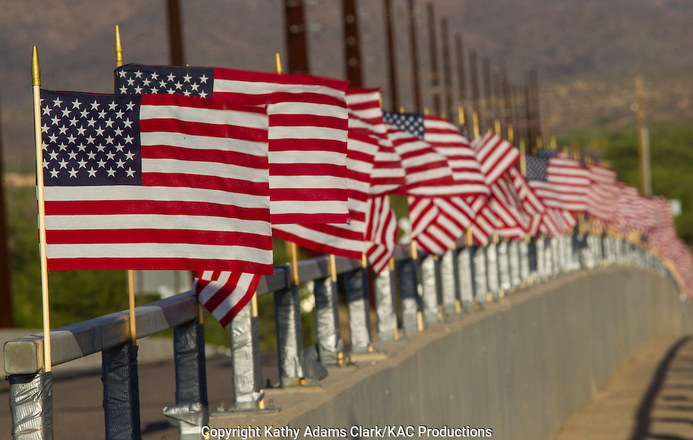 American flags over a bridge on Elephant Head Road, in southern Arizona.