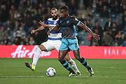 Queens Park Rangers midfielder Sandro and Sheffield Wednesday midfielder Jose Semedo during the Sky Bet Championship match between Queens Park Rangers and Sheffield Wednesday at the Loftus Road Stadium, London, England on 20 October 2015. Photo by Jemma Phillips.