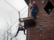 Olivia Grabill jumps off the zip line platform during the 'Zip line Adventure' oppurtunity held at the ridges on Feb. 3rd, during Sibs Weekend 2018.