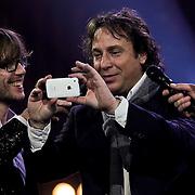 NLD/Amsterdam/20100415 - Uitreiking 3FM Awards 2010, Marco Borsato maakt een twitterfoto met Giel Beelen en Sander Lantinga