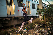 Ana Julia Martins of the Manguinhos community ballet, poses for a picture in the degraded surroundings of the Biblioteca Parque public library in Manguinhos neighbourhood in Rio de Janeiro, Brazil, Monday, June 11, 2018.  The Manguinhos community ballet has been a reprieve from the violence and poverty that afflicts its namesake neighborhood for hundreds of girls who have benefitted from free dance classes since 2012. (Dado Galdieri for The New York Times)