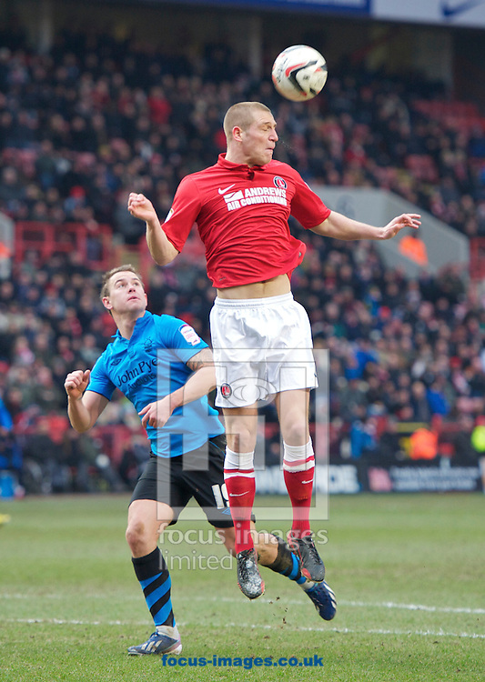 Picture by Alan Stanford/Focus Images Ltd +44 7915 056117.23/02/2013.Michael Morrison of Charlton Athletic heads clear from  Simon Cox of Nottingham Forest during the npower Championship match at The Valley, London.