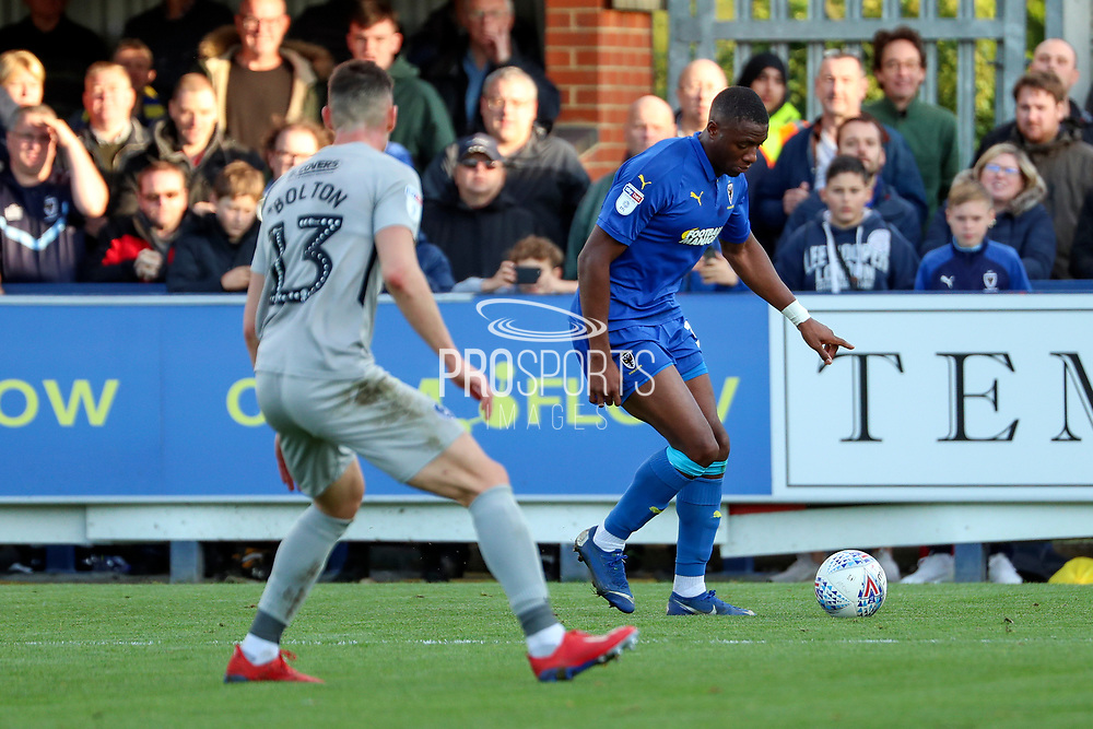 AFC Wimbledon defender Paul Kalambayi (30) taking on Portsmouth defender James Bolton (13) and about to shoot and hit the bar during the EFL Sky Bet League 1 match between AFC Wimbledon and Portsmouth at the Cherry Red Records Stadium, Kingston, England on 19 October 2019.