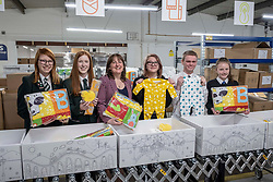 Pictured: Emily Wilson, (15) St Luke&rsquo;s High School Barrhead, Demi Burnett, (12) Banff Academy in Macduff, Holly Henry, (16) St Colkumba&rsquo;s Kilmacom, Maree Todd, Soinny Robertson,(17) Trinity Academy Edinburgh and Edith Macdonald, (13) Community School of Auchterarder.<br /><br />Children&rsquo;s Minister Maree Todd visited the APS distribution centre in Edinburgh where the baby boxes are printed, filled and distributed, to meet the young people behind the new baby box design.  The winning design was created by young people from Macduff, Auchterarder, Barrhead, Kilmacolm and Edinburgh as a result of a nationwide Young Scot competition celebrating the Year of Young People.<br /><br />Ms Todd presented an award to the winning design team and unveiled the redesigned baby box.<br /><br /><br />Ger Harley | EEm 27 March 2019