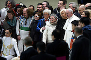 Jan 07th 2015 Vatican City, Pope Francis attends his weekly general audience. In the picture the pope poses for a picture with the artists of Liana Orfei Circus