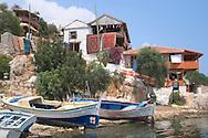 carpets and old wooden boats in Kalekoy<br /> Turkey<br /> c. Ellen Rooney
