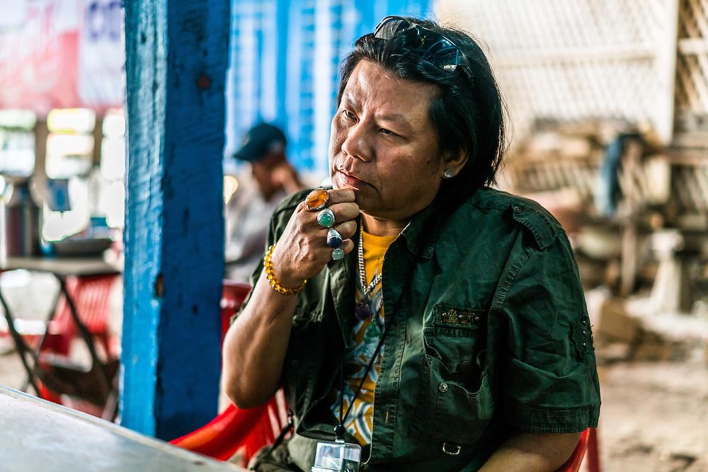 MYITKYINA, MYANMAR - MARCH 13th, 2016: Ko Kyaw, 49, a local jade trader in Kachin State.
