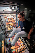 Georgia Ports Authority worker Lisa Tripp operates a Ship to Shore Crane at the port of Savannah, Monday, August 19, 2014, at the Garden City Terminal near Savannah, Ga.  (GPA Photo/Stephen B. Morton)