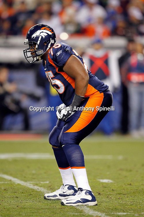 Denver Broncos offensive tackle Chris Clark (75) gets set during the NFL week 11 football game against the New York Jets on Thursday, November 17, 2011 in Denver, Colorado. The Broncos won the game 17-13. ©Paul Anthony Spinelli