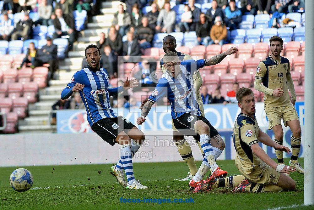 Wigan Athletic and Leeds United players watch as the ball runs across the Leeds United penalty area during the Sky Bet Championship match at the DW Stadium, Wigan<br /> Picture by Ian Wadkins/Focus Images Ltd +44 7877 568959<br /> 07/03/2015