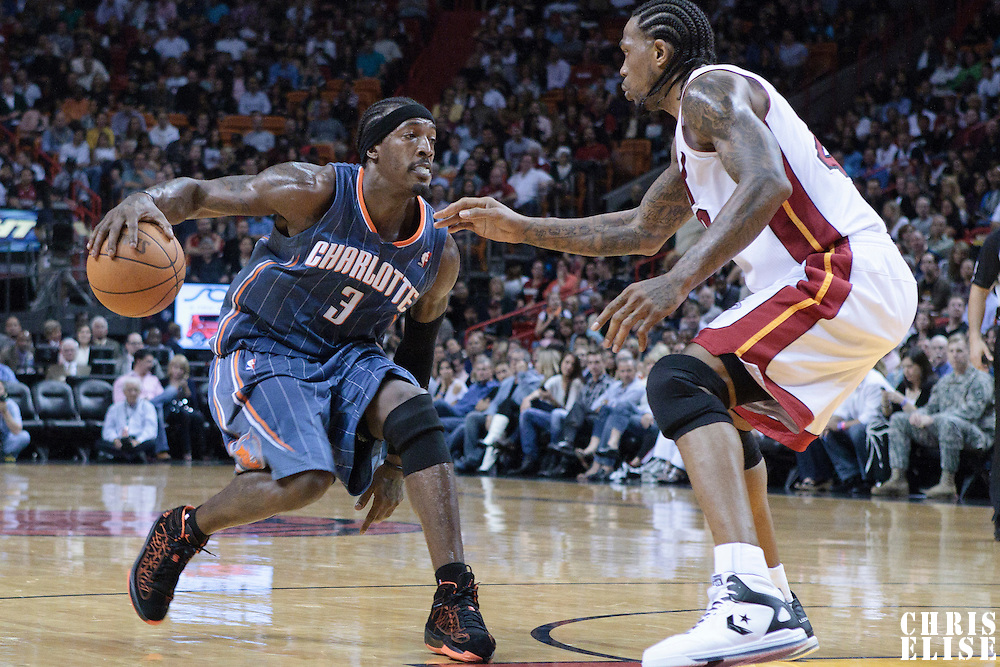 19 November 2010: Charlotte Bobcats' small forward #3 Gerald Wallace drives past Miami Heat's power forward #40 Udonis Haslem during the Miami Heat 95-87 victory over the Charlotte Bobcats at the AmericanAirlines Arena, Miami, Florida, USA.