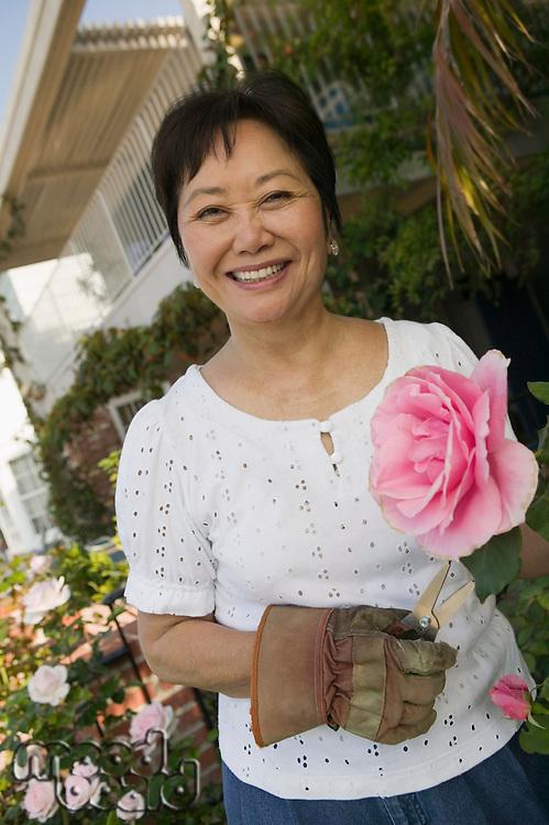 Gardener with Beautiful Pink Rose