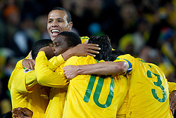 Players of Brazil celebrate after Juan scored during the 2010 FIFA World Cup South Africa Round of Sixteen match between Brazil and Chile at Ellis Park Stadium on June 28, 2010 in Johannesburg, South Africa.  (Photo by Vid Ponikvar / Sportida)
