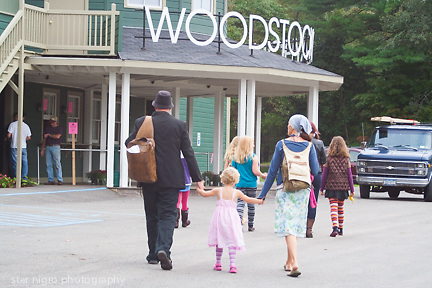 about photo: scene in front of Woodstock Playhouse featuring films from Woodstock Film festival.<br /> <br /> Story by Woodstock,NY &quot; colony of the arts&quot; by Star Nigro.<br /> <br /> This small town is considered one of the most famous towns with a rich history.<br /> <br /> Born and raised in Woodstock, NY, I have been greatly influenced unknowingly as a photographer/ artist surrounded by artists &amp; musicians.<br />  <br /> The elder historians of the community have sparked my intrigue to share this unique towns people, local scenes &amp; way of life.