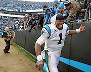 Carolina Panthers quarterback Cam Newton (1) celebrates with fans after the second half of an NFL divisional playoff football game against the Seattle Seahawks, Sunday, Jan. 17, 2016, in Charlotte, N.C. The Panthers won 31-24. (AP Photo/Mike McCarn)