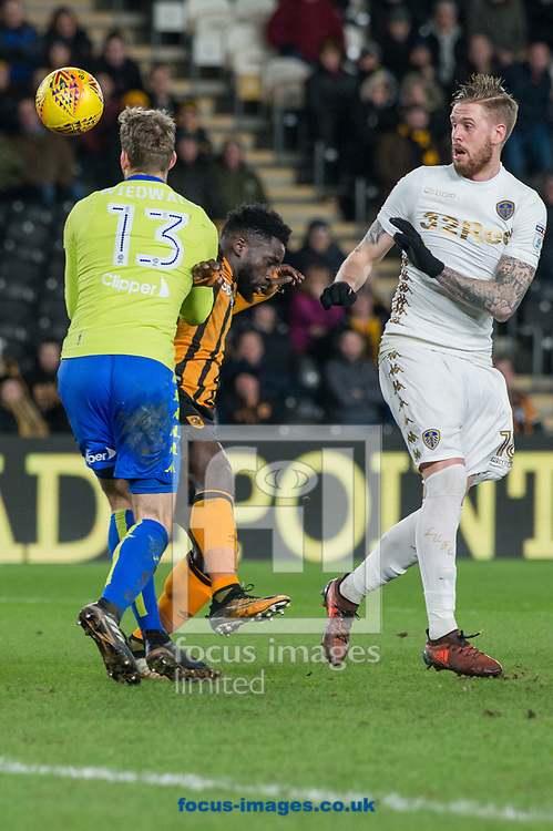 Nouha Dicko of Hull City in a collision with Leeds United goalkeeper Felix Wiedwald as Pontus Jansson of Leeds United looks on during the Sky Bet Championship match at the KCOM Stadium, Hull<br /> Picture by Matt Wilkinson/Focus Images Ltd 07814 960751<br /> 30/01/2018
