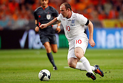 Wayne Rooney (ENG) attacks during the International Friendly between Netherlands and England at the Amsterdam Arena on August 12, 2009 in Amsterdam, Netherlands.