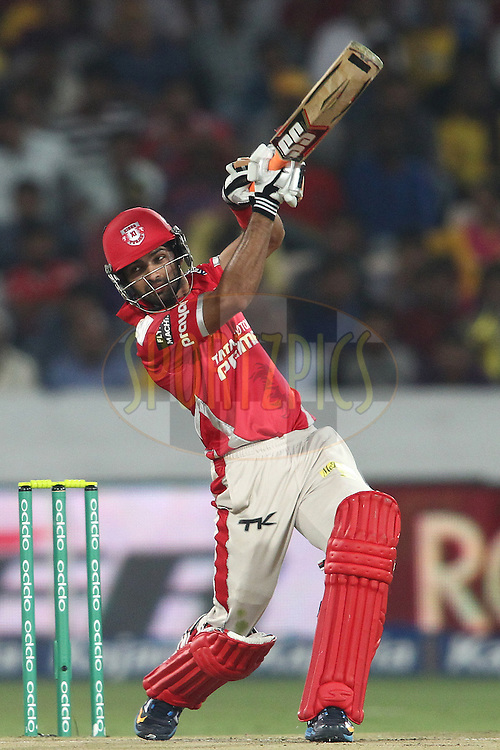 Manan Vohra of the Kings XI Punjab hits over the top for a boundary during the second semi final match of the Oppo Champions League Twenty20 between the Kings XI Punjab and the Chennai Superkings held at the Rajiv Gandhi Cricket Stadium, Hyderabad, India on the 2nd October 2014<br /> <br /> Photo by:  Shaun Roy / Sportzpics/ CLT20<br /> <br /> <br /> Image use is subject to the terms and conditions as laid out by the BCCI/ CLT20.  The terms and conditions can be downloaded here:<br /> <br /> http://sportzpics.photoshelter.com/gallery/CLT20-Image-Terms-and-Conditions-2014/G0000IfNJn535VPU/C0000QhhKadWcjYs