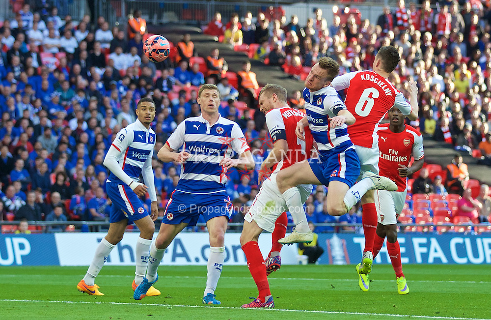 LONDON, ENGLAND - Saturday, April 18, 2015: Arsenal's captain Per Mertesacker in action against Reading during the FA Cup Semi-Final match at Wembley Stadium. (Pic by David Rawcliffe/Propaganda)