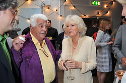 HRH The DUCHESS OF CORNWALL and ANTONIO CARLUCCIO at a party to celebrate the publication on 'Let's Eat: Recipes From My Kitchen Notebook' by Tom Parker Bowles held at Selfridge's Rooftop. Selfridge's, Oxford Street, London on 27th June 2012.