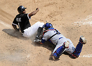 CHICAGO - MAY 22:  Juan Pierre #1 of the Chicago White Sox slides home safely on a sacrifice fly by Paul Konerko #14 as Rod Barajas #28 of the Los Angeles Dodgers makes a late tag in the fourth inning on May 22, 2011 at U.S. Cellular Field in Chicago, Illinois.  The White Sox defeated the Dodgers 8-3.  (Photo by Ron Vesely)  Subject:   Juan Pierre;Rod Barajas;Paul Konerko