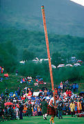 Tossing the Caber test of strength at the Braemar Games highland gathering in the rain  in Scotland.