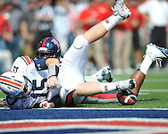 The ball is snapped over the head of Auburn quarterback Clint Moseley (15) and recovered by Mississippi defensive end C.J. Johnson (10) for a touchdown at Vaught-Hemingway Stadium in Oxford, Miss. on Saturday, October 13, 2012. (AP Photo/Oxford Eagle, Bruce Newman)..