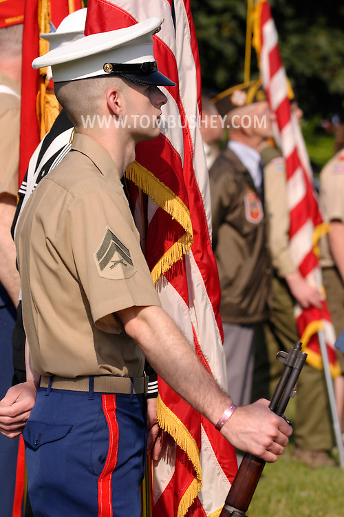 Town of Wallkill, N.Y. - A Marine stands with his rifle during a Memorial Day service at the Town of Wallkill Memorial Park on May 29, 2006. A life member of the Veterans of Foreign Wars, left, and two Boy Scouts bow their heads durining Memorial Day services at Town of Wallkill Memorial Park on May 31, 2006. © Tom Bushey