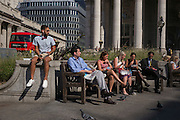 City workers enjoy sunshine in Bank Triangle during an unusual autumn heatwave on 13th September 2016, in the City of London, England.