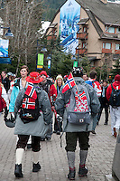 Visitors wear Norwegian flags and traditional clothing during the 2010 Olympic Winter Games in Whistler, BC Canada.