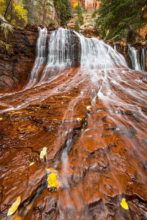 Water rushes over one of the many sandstone ledges along Zion National Park's Subway hike.