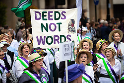 © Licensed to London News Pictures . 17/06/2018. Manchester , UK . Suffragettes . The 2018 Manchester Day parade , celebrating Manchester's cultural and social life and diversity, passes through Manchester City Centre . Photo credit : Joel Goodman/LNP