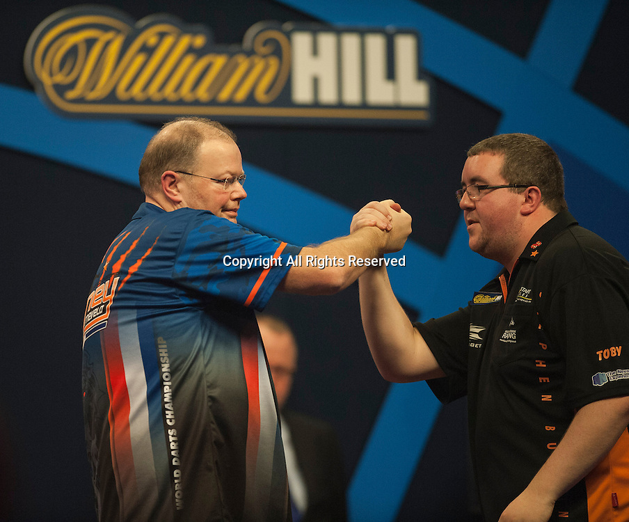 02.01.2014.  London, England.  William Hill PDC World Darts Championship.  Quarter Final Round. Raymond van Barneveld (14) [NED] shakes hands with  Stephen Bunting (27) [ENG] after their match. Raymond van Barneveld won the match 5-4