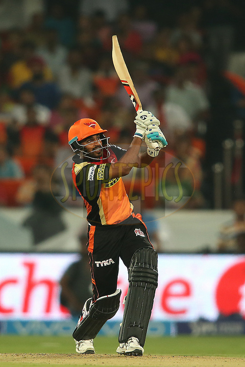 Bhuvneshwar Kumar of Sunrisers Hyderabad hits over the top for six during match 22 of the Vivo IPL 2016 (Indian Premier League) between the Sunrisers Hyderabad and the Rising Pune Supergiants held at the Rajiv Gandhi Intl. Cricket Stadium, Hyderabad on the 26th April 2016<br /> <br /> Photo by Shaun Roy / IPL/ SPORTZPICS