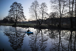 © Licensed to London News Pictures. 02/01/2017. Godalming, UK. A canoeist makes his way along the River Wey near Godalming at sunrise, on a cold winter morning. Photo credit: Peter Macdiarmid/LNP