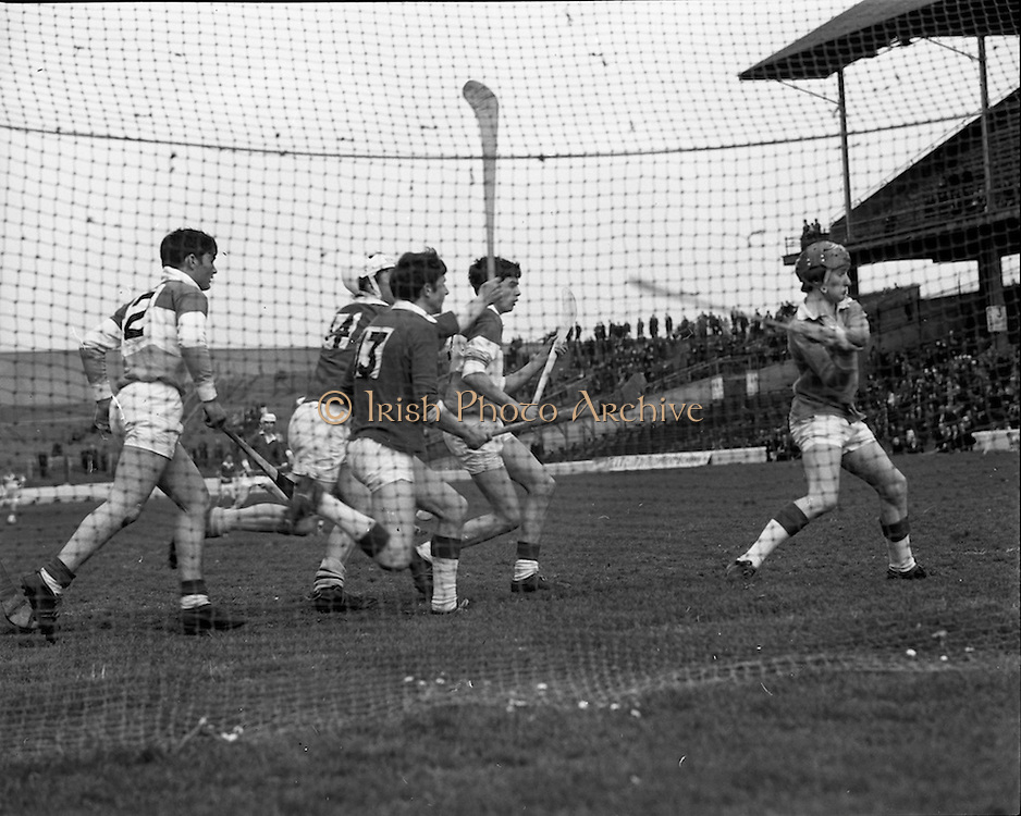 03/05/1970<br /> 05/03/1970<br /> 3 May 1970<br /> National Schools Hurling Final: Cork v Offaly at Croke Park, Dublin. <br /> Offaly goalkeeper, Haran (right) clars as Cork forwards, O'Brien (14) and O'Leary, move in.