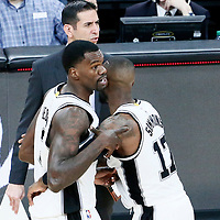 01 May 2017: San Antonio Spurs center Dewayne Dedmon (3) is restrained by San Antonio Spurs guard Jonathon Simmons (17) during the Houston Rockets 126-99 victory over the San Antonio Spurs, in game 1 of the Western Conference Semi Finals, at the AT&T Center, San Antonio, Texas, USA.