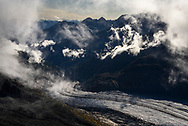 Shreds of clouds over peaks and the Aletsch Glacier, Valais, Switzerland
