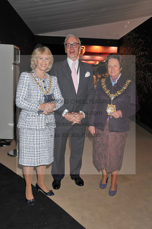 Left to right, The Lord Mayor of Westminster – COUNCILLOR SUSIE BURBRIDGE, LORD CHADLINGTON and the Lord Mayor of Hammersmith & Fulham COUNCILLOR FRANCES STAINTON at a preview evening of the annual London LAPADA (The Association of Art & Antiques Dealers) antiques Fair held in Berkeley Square, London on 20th September 2011.
