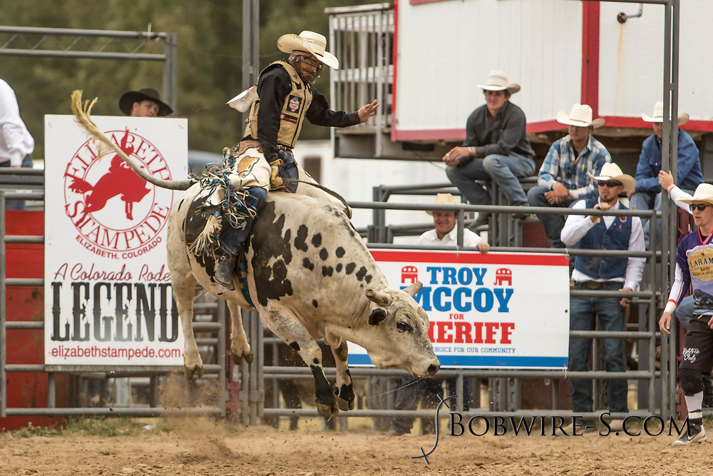 Bull rider Cole Fischer rides Summit Pro Rodeo's Road Trip during the third performance of the Elizabeth Stampede on Sunday, June 3, 2018.