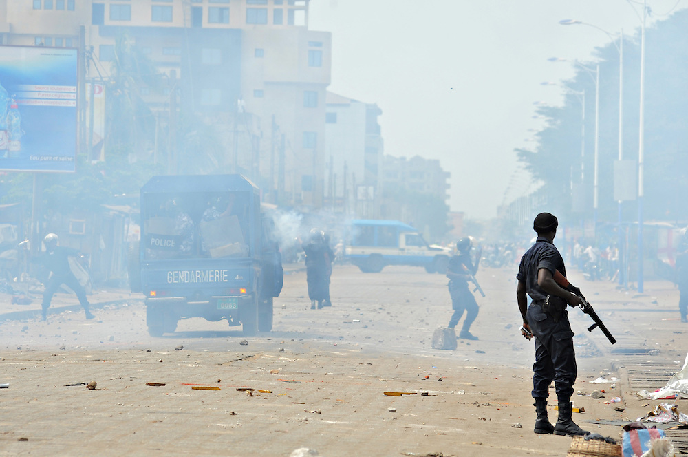 LOME, TOGO -  13-01-10   - Security forces patrol a street in Lome as they clash with protesters. Shortly after gathering for the first in three days of planned demonstrations, protesters clashed with police in Lome, Togo on January 10. Opposition groups are calling for the resignation of President Faure Gnassingbe, whose family has been in power for over 40 years.   Photo by Daniel Hayduk