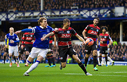 LIVERPOOL, ENGLAND - Saturday, January 4, 2014: Everton's Nikica Jelavic in action against Queens Park Rangers' Clint Hill during the FA Cup 3rd Round match at Goodison Park. (Pic by David Rawcliffe/Propaganda)