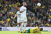 Leeds United defender Pontus Jansson (18) commits a foul on Norwich City striker (on loan from Sheffield Wednesday) Jordan Rhodes (11)  during the EFL Sky Bet Championship match between Norwich City and Leeds United at Carrow Road, Norwich, England on 25 August 2018.
